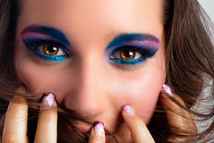 Young model with colorful makeup Royalty Free Stock Images