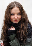 Young model with dark hairs. Fall. Autumn. Young cute girl with long dark hairs. Fall. Autumn. Outdoor session Stock Photo