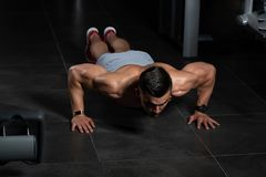 Model Exercising Push Ups. Young Model Doing Push Ups As Part Of Bodybuilding Training stock images