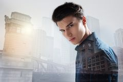 Young model expressing calmness in urban surrounding. City life. Close up of young charismatic model standing in urban surrounding while expressing calmness Royalty Free Stock Photo