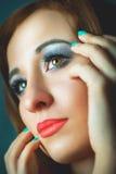 Young model face close-up beautiful makeup Stock Photography