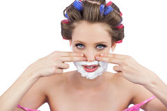 Young model with fingers on face and shaving foam Royalty Free Stock Photography