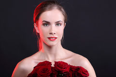 Young model with flowers Stock Photography