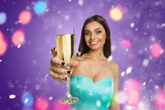 Young model with glass of champagne Stock Photos