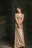 Young model in glowing dress Royalty Free Stock Photos