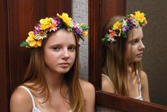 Young model had a flower diade. M near mirror Stock Photo