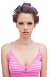 Young model with hair curlers Royalty Free Stock Photos