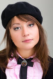 Young model in hat on the gray background Stock Photo