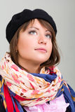 Young model in hat on the gray background Royalty Free Stock Image