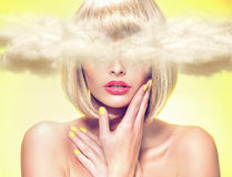 Young model with head in the clouds Royalty Free Stock Images