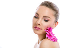 Young model with healthy clear skin. Beauty girl, model with flower on shoulder, healthy clear skin, youth, isolated on white background, skincare concept Royalty Free Stock Photos