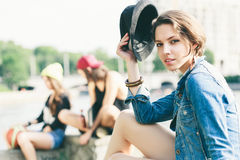 Young model in jeans jacket. Young woman posing in jeans jacket with hat. Outdoors, lifestyle Royalty Free Stock Photos