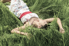 Young model laying in the grass Stock Image
