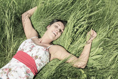 Young model laying in the grass Royalty Free Stock Photography