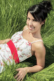 Young model laying in the grass Royalty Free Stock Photos