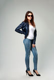 Young model in leather jacket and sunglasses Stock Images