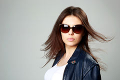 Young model in leather jacket and sunglasses Stock Photo