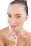 Young model with lip balm Stock Image