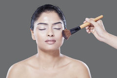 Young model with makeup brushes Stock Photo