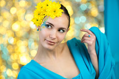 Young model with makeup and flowers in her hair Royalty Free Stock Photography
