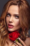 Young model with natural makeup and perfect skin. Beauty fashion portrait of young blond woman model with natural makeup and perfect skin with beautiful rose stock photos