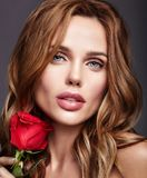 Young model with natural makeup and perfect skin. Beauty fashion portrait of young blond woman model with natural makeup and perfect skin with beautiful rose royalty free stock images