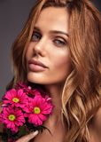 Young model with natural makeup and perfect skin. Beauty fashion portrait of young blond woman model with natural makeup and perfect skin with bright сrimson royalty free stock photography