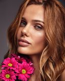 Young model with natural makeup and perfect skin. Beauty fashion portrait of young blond woman model with natural makeup and perfect skin with bright сrimson stock images