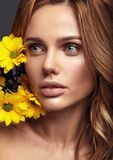 Young model with natural makeup and perfect skin. Beauty fashion portrait of young blond woman model with natural makeup and perfect skin with bright yellow royalty free stock image