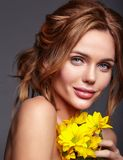 Young model with natural makeup and perfect skin. Beauty fashion portrait of young blond woman model with natural makeup and perfect skin with bright yellow stock image