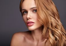 Young model with natural makeup and perfect skin. Beauty fashion portrait of young blond woman model with natural makeup and perfect skin posing in studio royalty free stock images