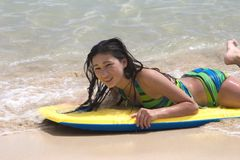 Young model in the ocean. Young model on a board in the ocean Royalty Free Stock Photos