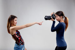 Young model with young photographer Royalty Free Stock Photos