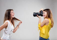 Young model with young photographer Stock Images