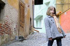 Young model posing with old houses in background Stock Photography