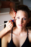 Young Model Receiving Makeup Treatment Stock Photo