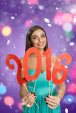 Young model with red sign of New Year Royalty Free Stock Images