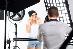Young model relaxes while taking theme photos. Time to chuckle. Young attractive model giggles lightly when being photographed royalty free stock images