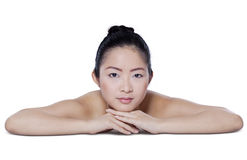 Young model relaxing after facial treatment Stock Photography