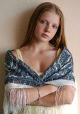 Young model in Russian scarf. Portrait of young long-haired model threw a shawl over Stock Photography