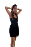 Young model screaming laud. Young model in a black dress, screaming with heads and her head Royalty Free Stock Photos