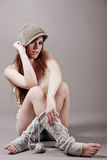 Young model sitting in autumn clothes stock photography