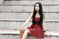 Young model sitting on stairs Royalty Free Stock Photo