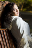 Young model sitting on a wooden bench Stock Photos