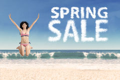 Young model with spring sale cloud Stock Photo