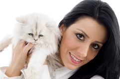 Young model standing with white kitten Stock Photography