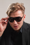 Young model in sunglasses. Young blond male model in sunglasses looking arrogant Stock Photography