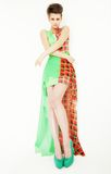 Young model wearing green dress posing Stock Photo