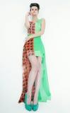 Young model wearing green dress posing Royalty Free Stock Photo