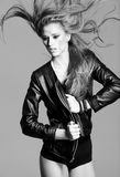 Young model wearing a leather jacket posing fashion Stock Image
